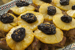 Moroccan dish with meat, pineapple and prunes Stock Photo