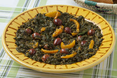 Moroccan dish with spinach, olives and preserved lemon Stock Images
