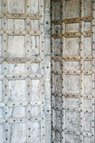 Moroccan door. Old weathered hand made door standing open royalty free stock photography