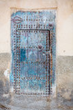Moroccan door. Old blue door decorated with iron detail Stock Images