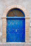 Moroccan door. Old blue door decorated with iron detail Royalty Free Stock Images