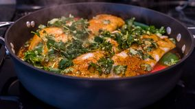 Moroccan Fish. Cooking on the stove with chemoula and peppers. Close up stock photo