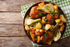 Moroccan food: pieces of chicken baked with fennel and potatoes Stock Photos