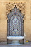 Moroccan fountain with mosaic tiles Stock Images