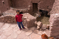 Moroccan gir in front of traditional house. Morocco stock photography