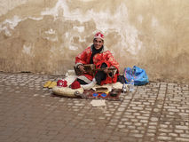 Moroccan Gnawa street musician playing gumbri Stock Photos