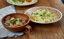 Goat tagine with toasted nut couscous stock photography