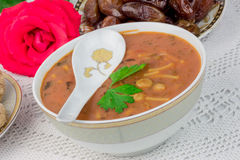 Moroccan harira soup with dates Royalty Free Stock Photography