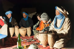 Moroccan hosts in desert camp Royalty Free Stock Image