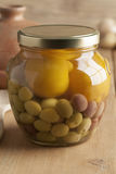 Moroccan jar with olives and lemons Stock Photography