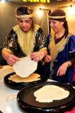 Moroccan Jewish woman baking mufleta Royalty Free Stock Photo