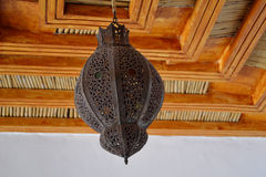 Moroccan lamp. Moroccan lamp with openwork forged inlaid colored glass stock images