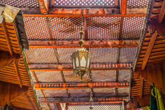 Moroccan lantern and cedar wood carved ceiling Royalty Free Stock Photography