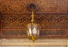 Moroccan lantern and cedar wood carved ceiling Stock Images