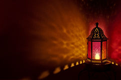 Moroccan lantern with colored glass at night time Royalty Free Stock Photo