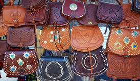 Moroccan leather goods bags in a row at market Royalty Free Stock Photo