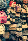 Moroccan leather goods bags in a row at outdoor market Royalty Free Stock Image