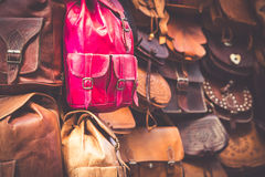 Moroccan leather goods bags in a row at outdoor market Royalty Free Stock Photography