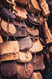 Moroccan leather goods bags in a row at outdoor market Royalty Free Stock Photos