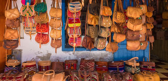 Moroccan leather goods bags in a row at outdoor market. In Essaouira Royalty Free Stock Images