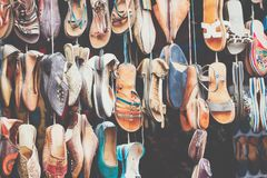 Moroccan leather goods bags and slippers at outdoor market in Ma. Rrakesh, Morocco Royalty Free Stock Photography