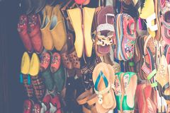 Moroccan leather goods bags and slippers at outdoor market in Ma. Rrakesh, Morocco Royalty Free Stock Images