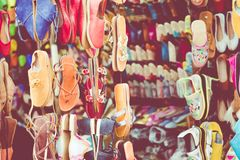 Moroccan leather goods bags and slippers at outdoor market in Ma. Rrakesh, Morocco Stock Photos