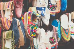 Moroccan leather goods bags and slippers at outdoor market in Ma. Rrakesh, Morocco Royalty Free Stock Image