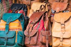 Moroccan leather goods bags and slippers at outdoor market in Ma. Rrakesh, Morocco Stock Image