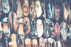 Moroccan leather goods bags and slippers at outdoor market in Ma. Rrakesh, Morocco Stock Photo