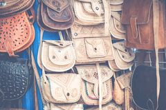 Moroccan leather goods bags and slippers at outdoor market in Ma. Rrakesh, Morocco Royalty Free Stock Photos