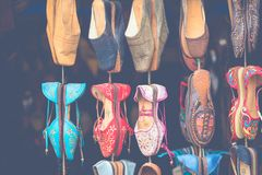 Moroccan leather goods bags and slippers at outdoor market in Ma. Rrakesh, Morocco Royalty Free Stock Photo