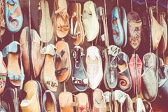 Moroccan leather goods bags and slippers at outdoor market in Ma. Rrakesh, Morocco Stock Photography