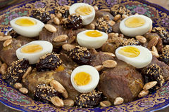 Moroccan meat, plums and eggs Royalty Free Stock Image