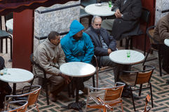 Moroccan men drinking tea in a side walk cafe. In the medina of Fez. December 01, 2008 in Fez, Morocco, Africa Stock Image