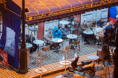 Moroccan men drinking tea in a side walk cafe Stock Images
