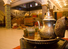 Moroccan mint tea. Traditional moroccan mint tea served in glasses from silver teapot in carpet shop Stock Photography