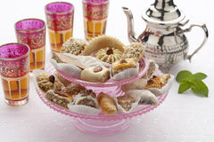 Moroccan mint tea and cookies. Moroccan high tea with cookies and mint tea on white background stock photo