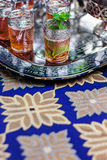 Moroccan mint tea service on blue tablecloth Royalty Free Stock Photos