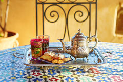 Moroccan mint tea with sweets. Traditional Moroccan mint tea with sweets royalty free stock image
