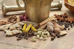 Moroccan Mortar, pestle and herbs Stock Photos