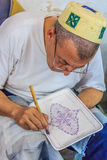 Moroccan mozaic artist at work Stock Photo