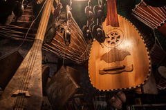 Moroccan Musical Instruments. Moody, light-and-shadow display of several traditional Arabic stringed and percussion instruments in a small store in Morocco royalty free stock images