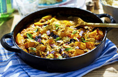 Moroccan one pot tajine. Fried chicken with pumpkin, cherries and red onion stock photography