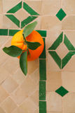 Moroccan orange fruit on mosaic ceramic Royalty Free Stock Photo