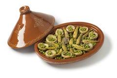 Moroccan oval tajine with meat, okra, green peas and artichoke Stock Photos