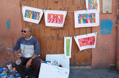 Moroccan Painter in Marrakech Stock Photography