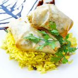 Moroccan Pastilla with saffron rice Stock Images