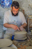 Moroccan potter at work Stock Photography