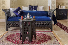 Moroccan room suite. Luxury suite bedroom and couch in moroccan style Royalty Free Stock Photography